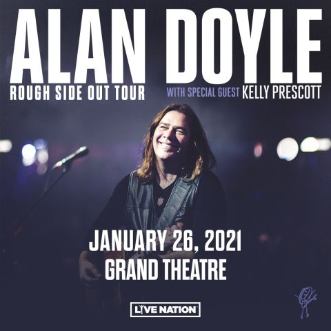 Alan Doyle with guitar on stage