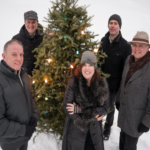 The Barra MacNeils with a Christmas Tree in the snow