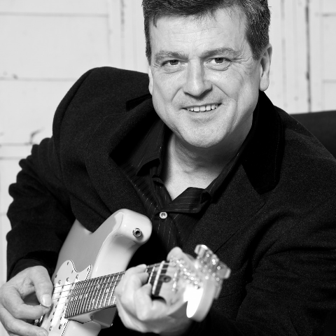 Les McKeown playing guitar.