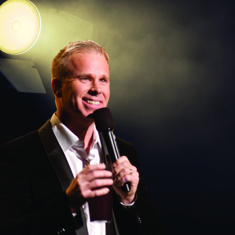 Gerry Dee on a stage, alone.
