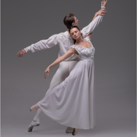 A male and female dancer both dressed in white.