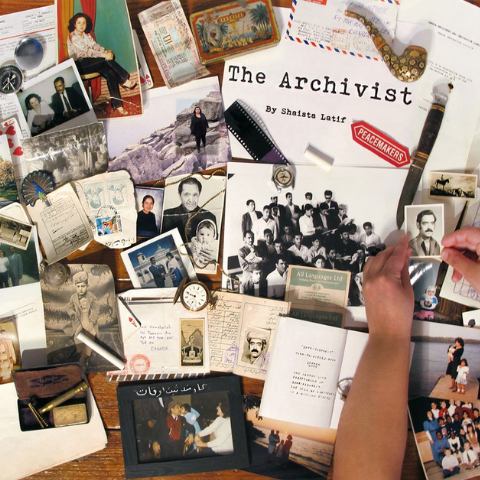 Collection of papers and photographs on a table.