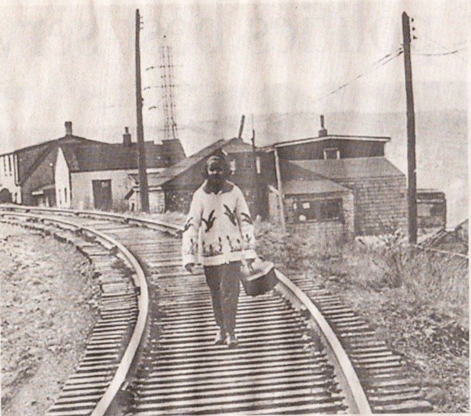 Woman walking down tracks in Africville