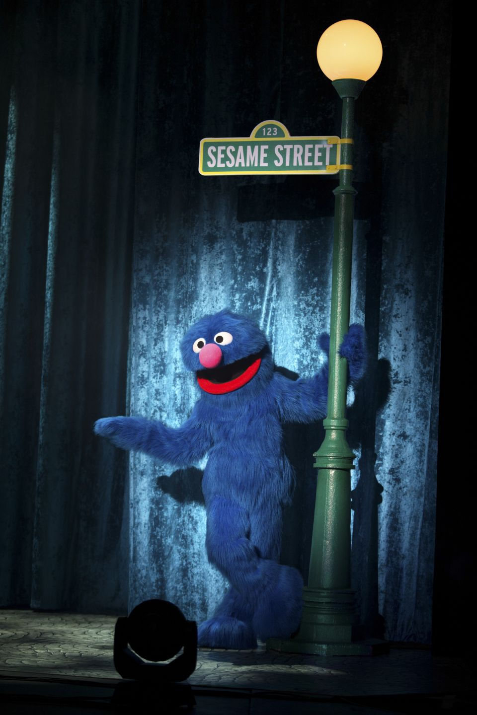 Grover standing under a street lamp