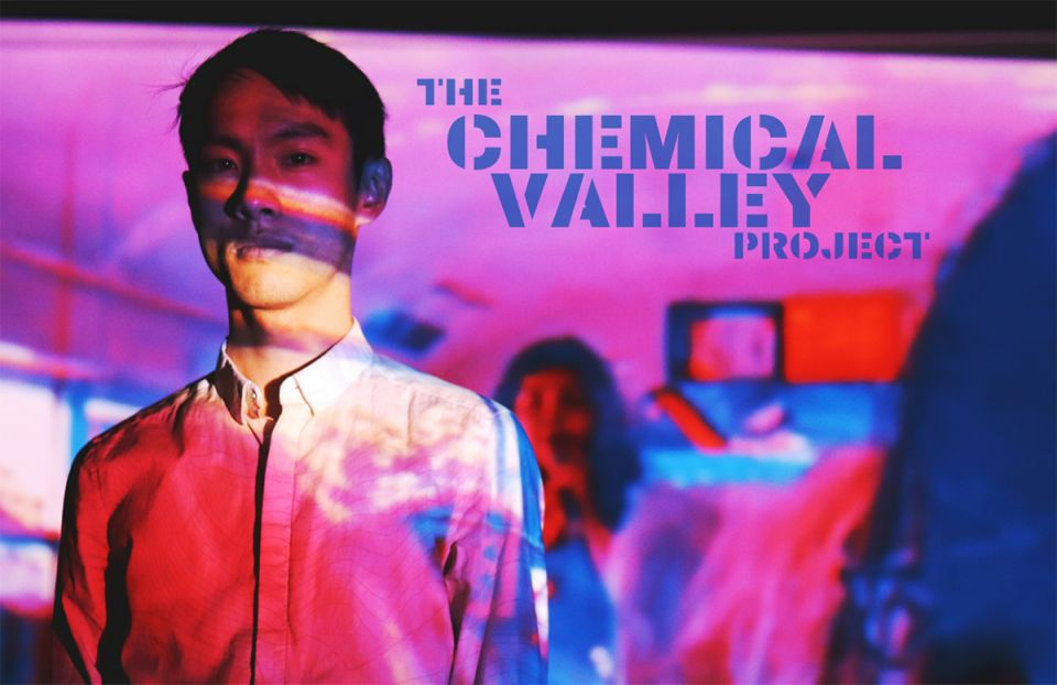 Colourful background with performers and the title of the event which is The Chemical Valley Project